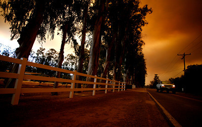 Smoke and ashes scattered all over Ventura County creating a thick black red layer of smoke from the near by Santa Rosa Valley fire including Stockton Road in Moorpark, CA.  (Ernesto Elizarraraz, Special to the Daily News)