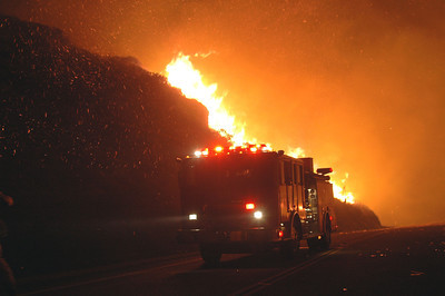 Embers fly as winds push a monster fire through the hills of Malibu, CA.  Mike Meadows/Special to the Daily News.