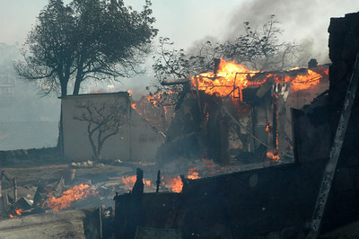 A home burns to the ground along Malibu Knoll Road in Malibu, CA. on Sunday.  Photo by Mike Meadows/Special to the Daily News.