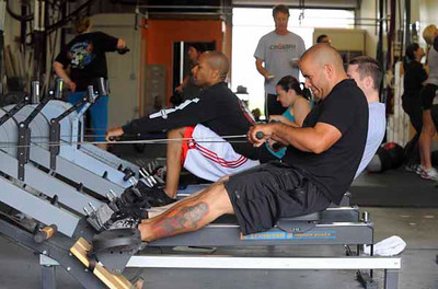 LONG BEACH - 04/24/2010 - (Scott Varley/Daily Breeze) People take part in a Tabata workout at CrossFit Long Beach. Tabata is a workout method where participants exercise at intense levels for 20 seconds followed by 10 seconds of rest for 8 cycles.  Greg Cisneros works out on the rowing machine during the workout.