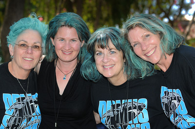 (l-r) Diane Seiger, Leslie Hick, Janet Kiddoo and Laverne Potter show off their new hair color. The students at Daniel Pearl Magnet High School dyed their teachers hair turquoise and black, Daniel Pearl's school colors, after the school reached an API score of 800, based on student test scores. The color, sprayed out of aerosol cans, will be worn in the educators hair for the next week. Van Nuys, CA. 9-1-2011. (John McCoy/Staff Photographer)