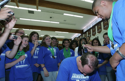 Lake Los Angeles, CA - As promised to his students, Challenger Middle School teacher and pentathlon coach Bruce Galler gets his head shaved by seventh-grader Edward Bravo on Monday, June 11, 2007 in the school's multi-purpose room as other members of the team watch, photograph and take video footage for their MySpace pages after the school's five Academic Pentathlon teams brought home a total of 79 individual medals and eight team awards with an additional 72 medals from the 2007 Orange County Academic Pentathlon competition for a total of 151 which set a school record since it's participation in the competition starting in 1994.  (John Lazar/L.A. Daily News Staff Photographer)