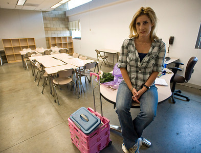 Laura Bart, a sixth grade teacher who was laid off from Roy Romer Middle School, sits in her empty classroom after clearing her belongings on her final day. Teachers who have been laid off pack up their offices and classrooms on the final school day of the year at Roy Romer Middle School in North Hollywood on Friday, June 24, 2011.  (Maya Sugarman/Staff Photographer)