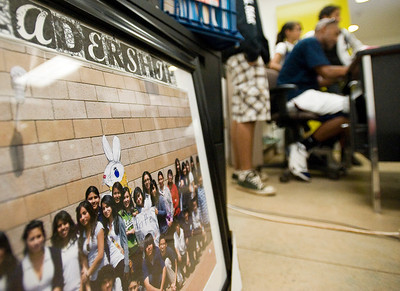 Students in Leadership gave Williams a framed photograph of the group with notes from each student, as a goodbye gift. Teachers who have been laid off pack up their offices and classrooms on the final school day of the year at Roy Romer Middle School in North Hollywood on Friday, June 24, 2011.  (Maya Sugarman/Staff Photographer)