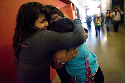 Eighth graders Karla Medellin, Nicole Contreras, and Aline Corona embrace at the end of their last day of school at Roy Romer Middle School in North Hollywood on Friday, June 24, 2011.  (Maya Sugarman/Staff Photographer)