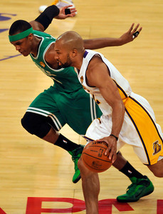 Rajon Rondo hussles along with Derek Fisher in the first half. The Celtics defeated the Lakers 104-93 in game two of the NBA Finals at Staples Center in Los Angeles , CA 6/6/2010. photo by John McCoy/staff photographer