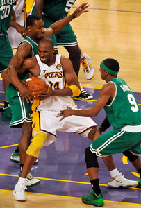 Celtics Tony Allen and Rajon Rondo put preasure on Kobe Bryant in the late minutes of the 4th quarter. The Celtics defeated the Lakers 104-93 in game two of the NBA Finals at Staples Center in Los Angeles , CA 6/6/2010. photo by John McCoy/staff photographer