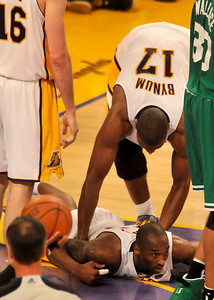 Andrew Bynum picks up Kobe Bryant from the floor in the 2nd quarter. The Lakers hosted the Celtics  in game two of the NBA Finals at Staples Center in Los Angeles , CA 6/6/2010. photo by John McCoy/staff photographer