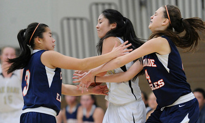 Chaminade#3 Alyanna Gan and Chaminade#4 Natalie Valenzuela wrap up Oak Park #21 Erin Matsumoto. The Chaminade Girls Basketball team played host to the girls from Oak Park in a game played in West Hills, CA 12/14/2011(John McCoy/Staff Photographer)