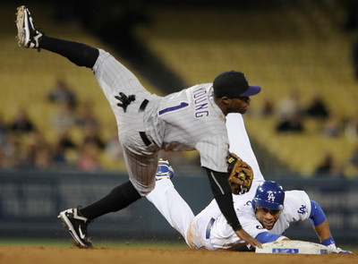 Eric Young falls over James Loney after converting a double play in the 6th inning. The Dodgers hosted the Colorado Rockies in a game at Dodger Stadium.  Los Angeles, CA 5-31-2011. (John McCoy/Staff Photographer)
