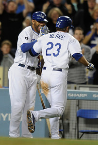 Matt Kemp congratulates Casey Blake on his 3 run homer after he drove in GIbbons and Carroll in the 7th inning. The Dodgers defeated the Colorado Rockies 8-2  in a game at Dodger Stadium.  Los Angeles, CA 5-31-2011. (John McCoy/Staff Photographer)