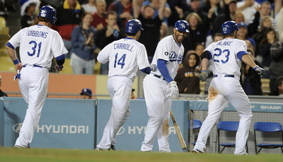 Matt Kemp center congratulates Casey Blake after he drove in GIbbons and Carroll in the 7th inning. The Dodgers defeated the Colorado Rockies 8-2  in a game at Dodger Stadium.  Los Angeles, CA 5-31-2011. (John McCoy/Staff Photographer)