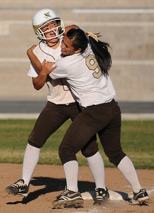 Kennedy Alija Ramirez gets a hug from Danielle Estrada after Ramirez walked in the winning run. The Kennedy girls softball team defeated San Fernando 7-6 in a game played at Kennedy High School in Granada Hills, CA 3/21/2012(John McCoy/Staff Photographer)