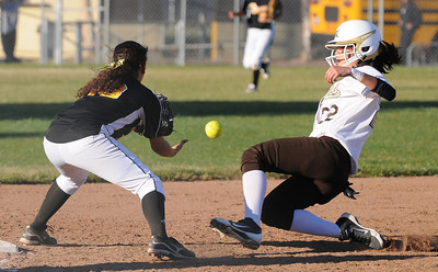 San Fernando #18 Breanna Cabrera gets the throw late at 3rd base allowing Kennedy #8 Melinda Alcantar to advance in the 7th inning.  The Kennedy girls softball team defeated San Fernando 7-6 in a game played at Kennedy High School in Granada Hills, CA 3/21/2012(John McCoy/Staff Photographer)