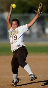 Danielle Estrada winds up for a pitch. The Kennedy girls softball team defeated San Fernando 7-6 in a game played at Kennedy High School in Granada Hills, CA 3/21/2012(John McCoy/Staff Photographer)