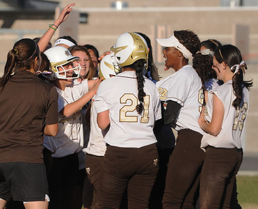 The Kennedy girls softball team celebrates after they defeated San Fernando 7-6 in a game played at Kennedy High School in Granada Hills, CA 3/21/2012(John McCoy/Staff Photographer)