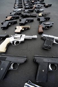 A box full of guns was lined up and counted after they were brought in by someone who police assumed was a property master in the film industry. All of the weapons, while possibly used for movies, were all operable guns that could still fire a bullet. The LAPD held their 3rd annual Gun Buy Back program at six locations throughout the city, including the Parking lot at Facey Medical Center on Sepulveda Blvd. in Mission Hills.  The program allows people to anonymously turn in guns to the LAPD and receive a gift card to purchase food at Ralph's grocery stores. A $100 gift card was issued for a handgun; shotgun or rifle while a $200 card was given for weapons classified as assault weapons. Mission Hills, CA 5-7-2011. (John McCoy/staff photographer)