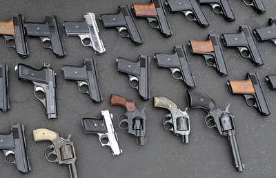 Guns are lined up and counted. The LAPD held their 3rd annual Gun Buy Back program at six locations throughout the city, including the Parking lot at Facey Medical Center on Sepulveda Blvd. in Mission Hills.  The program allows people to anonymously turn in guns to the LAPD and receive a gift card to purchase food at Ralph's grocery stores. A $100 gift card was issued for a handgun; shotgun or rifle while a $200 card was given for weapons classified as assault weapons. Mission Hills, CA 5-7-2011. (John McCoy/staff photographer)
