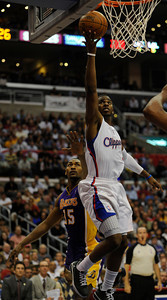 Los Angeles Clippers guard Chris Paul (3) drives past Los Angeles Lakers' Metta World Peace (15)  in the first half.  The Clippers hosted the Lakers at a game played at Staples Center in Los Angeles, CA 4/4/2012(John McCoy/Staff Photographer)