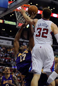 Laker center Andrew Bynum (17) is fouled by forward Blake Griffin (32) in the 4th quarter. The Lakers defeated the Clippers at home 113 to 108 during a cross town rivalry game at Staples Center in Los Angeles, CA 4/4/2012(John McCoy/Staff Photographer)
