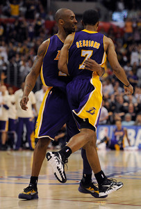 Los Angeles Lakers guard Kobe Bryant (24) gives a hug to guard Ramon Sessions (7) after a hoop late in the 4th quarter. The Lakers defeated the Clippers at home 113 to 108 during a cross town rivalry game at Staples Center in Los Angeles, CA 4/4/2012(John McCoy/Staff Photographer)