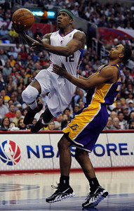 Los Angeles Clippers guard Eric Bledsoe (12) gets past Los Angeles Lakers guard Ramon Sessions (7) in the second quarter. The Clippers hosted the Lakers at a game played at Staples Center in Los Angeles, CA 4/4/2012(John McCoy/Staff Photographer)