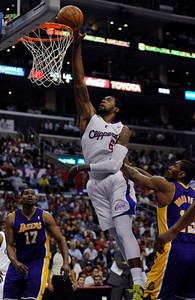 Los Angeles Clippers center DeAndre Jordan (6) gets past Los Angeles Lakers forward Metta World Peace (15) and Los Angeles Lakers center Andrew Bynum (17) in the first half. The Clippers hosted the Lakers at a game played at Staples Center in Los Angeles, CA 4/4/2012(John McCoy/Staff Photographer)