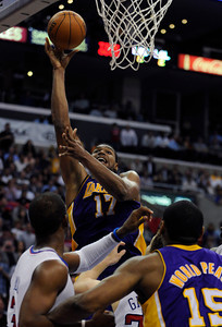 Los Angeles Lakers center Andrew Bynum (17) gets two of his 36 points in the 4th. The Lakers defeated the Clippers at home 113 to 108 during a cross town rivalry game at Staples Center in Los Angeles, CA 4/4/2012(John McCoy/Staff Photographer)