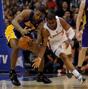 Los Angeles Lakers forward Metta World Peace (15) steals the ball from Los Angeles Clippers guard Chris Paul (3) in the 4th. The Lakers defeated the Clippers at home 113 to 108 during a cross town rivalry game at Staples Center in Los Angeles, CA 4/4/2012(John McCoy/Staff Photographer)