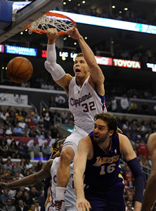 Blake Griffin (32) dunks over Pau Gasol (16) of Spain in the first quarter. The Clippers hosted the Lakers at a game played at Staples Center in Los Angeles, CA 4/4/2012(John McCoy/Staff Photographer)