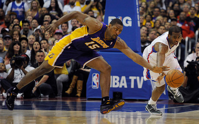 Los Angeles Lakers forward Metta World Peace (15) steals the ball from Los Angeles Clippers guard Chris Paul (3) in the 4th quarter. The Lakers defeated the Clippers at home 113 to 108 during a cross town rivalry game at Staples Center in Los Angeles, CA 4/4/2012(John McCoy/Staff Photographer)