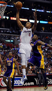 Los Angeles Clippers forward Caron Butler (5) gets past Los Angeles Lakers guard Kobe Bryant (24) in the scond quarter. The Clippers hosted the Lakers at a game played at Staples Center in Los Angeles, CA 4/4/2012(John McCoy/Staff Photographer)