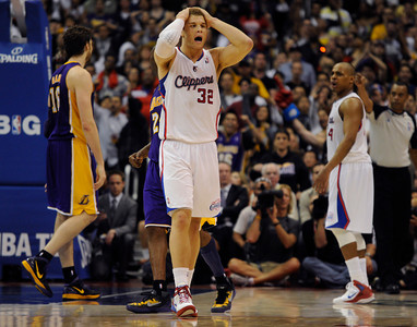 Los Angeles Clippers forward Blake Griffin (32) is dejected after fouling Los Angeles Lakers forward Pau Gasol (16) of Spain in the final moments of the game. The Lakers defeated the Clippers at home 113 to 108 during a cross town rivalry game at Staples Center in Los Angeles, CA 4/4/2012(John McCoy/Staff Photographer)