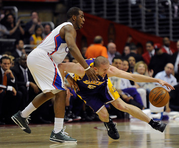 Los Angeles Lakers guard Steve Blake (5) gets away from Los Angeles Clippers guard Chris Paul (3) in the first half. The Clippers hosted the Lakers at a game played at Staples Center in Los Angeles, CA 4/4/2012(John McCoy/Staff Photographer)