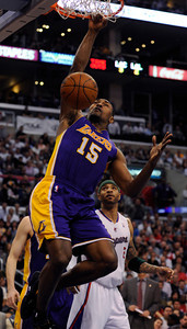 Laker forward Metta World Peace (15) dunks in the 4th quarter.  The Lakers defeated the Clippers at home 113 to 108 during a cross town rivalry game at Staples Center in Los Angeles, CA 4/4/2012(John McCoy/Staff Photographer)