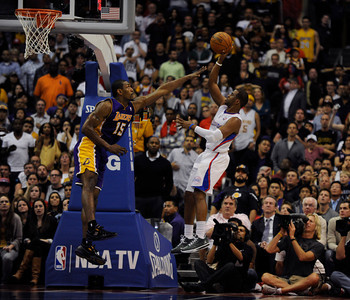 Los Angeles Lakers forward Metta World Peace (15) contests a shot by Los Angeles Clippers guard Chris Paul (3) in the final seconds. The Lakers defeated the Clippers at home 113 to 108 during a cross town rivalry game at Staples Center in Los Angeles, CA 4/4/2012(John McCoy/Staff Photographer)