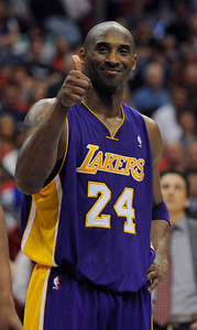 Los Angeles Lakers guard Kobe Bryant (24) gives a thumbs up in the final seconds of the game. The Lakers defeated the Clippers at home 113 to 108 during a cross town rivalry game at Staples Center in Los Angeles, CA 4/4/2012(John McCoy/Staff Photographer)