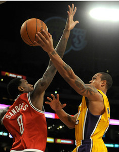 Shannon Brown shoots around Larry Sanders in the first half. The Lakers played host to the Milwaukee Bucks in a game played at Staples Center in Los Angeles, CA 12-21-2010. (John McCoy/staff photographer)