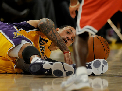 Matt Barnes lost the ball to Earl Boykins. The Lakers were defeated by the Milwaukee Bucks 98 to 79 in a game played at Staples Center in Los Angeles, CA 12-21-2010. (John McCoy/staff photographer)