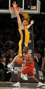 Earl Boykins gets Pau Gasol to leave his feet in the 4th quarter. The Lakers were defeated by the Milwaukee Bucks 98 to 79 in a game played at Staples Center in Los Angeles, CA 12-21-2010. (John McCoy/staff photographer)