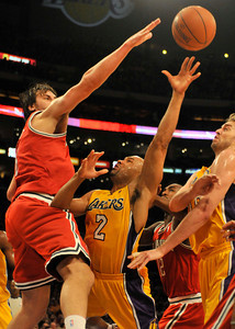 Bucks big man Andrew Bogut puts preasure on Lakers Derek Fisher. The Lakers played host to the Milwaukee Bucks in a game played at Staples Center in Los Angeles, CA 12-21-2010. (John McCoy/staff photographer)