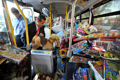 """Channel 7 weather man Garth Kemp, the Los Angeles Fire Department and Los Angeles Mayor Antonio Villaraigosa participated in a toy drive at the intersection of Topanga Canyon Blvd. and Ventura Blvd. The participants loaded donated toys collected during ABC7's """"Stuff-A-Bus"""" event into two Metro Busses to benefit the LAFD's """"Spark of Love"""" toy drive.  Woodland Hills CA.12-10-2010. (John McCoy/staff photographer)"""