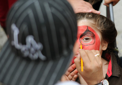 Miguel Mora, 3-years-old, has his face painted during the North Valley Caring Services Family Fair in North Hills Saturday, April 2, 20011. (Hans Gutknecht/Staff Photographer