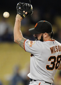 Brian Wilson fends off a hit ball in the 9th inning. The San Francisco Giants defeated the Dodgers 8-5 in a game played at Dodger Stadium in Los Angeles, CA 5-17-2011. (John McCoy/staff photographer)