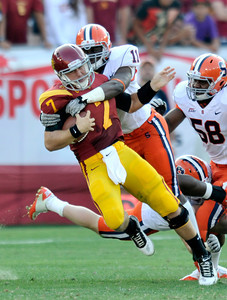 Southern California quarterback Matt Barkley is tackled after an open field run by Syracuse linebacker Marquis Spruill (11) in the 2nd quarter. The USC Trojans played the Orangemen of Syracuse in a game played at the Coliseum in Los Angeles, CA. 9-17-2011. (John McCoy/Staff Photographer)