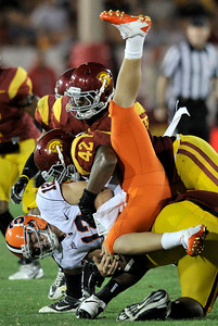 Syracuse quarterback Ryan Nassib (12) is tackled by Southern California defensive end Devon Kennard (42) in the 4th quarter. The USC Trojans defeated the Orangemen of Syracuse 38 to 17 in a game played at the Coliseum in Los Angeles, CA. 9-17-2011. (John McCoy/Staff Photographer)