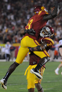 Southern California wide receiver Marqise Lee (9) is lifted in the air by Robert Woods after a 3rd quarter TD. The USC Trojans defeated the Orangemen of Syracuse 38 to 17 in a game played at the Coliseum in Los Angeles, CA. 9-17-2011. (John McCoy/Staff Photographer)