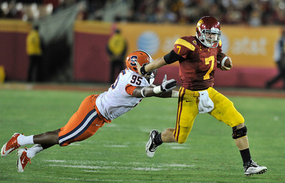 Syracuse defensive end Torrey Ball (95) gant get to Southern California quarterback Matt Barkley (7) in the 4th quarter. The USC Trojans defeated the Orangemen of Syracuse 38 to 17 in a game played at the Coliseum in Los Angeles, CA. 9-17-2011. (John McCoy/Staff Photographer)