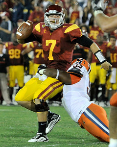 Southern California quarterback Matt Barkley (7) is sacked by Syracuse defensive end Torrey Ball (95) in the 4th quarter. The USC Trojans defeated the Orangemen of Syracuse 38 to 17 in a game played at the Coliseum in Los Angeles, CA. 9-17-2011. (John McCoy/Staff Photographer)