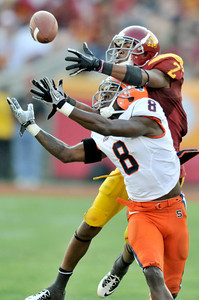 Syracuse cornerback Keon Lyn (8) interfears with Southern California wide receiver Robert Woods (2) on this play in the second quarter. The USC Trojans played the Orangemen of Syracuse in a game played at the Coliseum in Los Angeles, CA. 9-17-2011. (John McCoy/Staff Photographer)